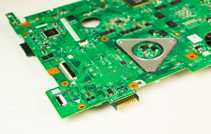 A green circuit board, solderings and paths. Circuit board with electronic components. Computer and networking communication stock photography