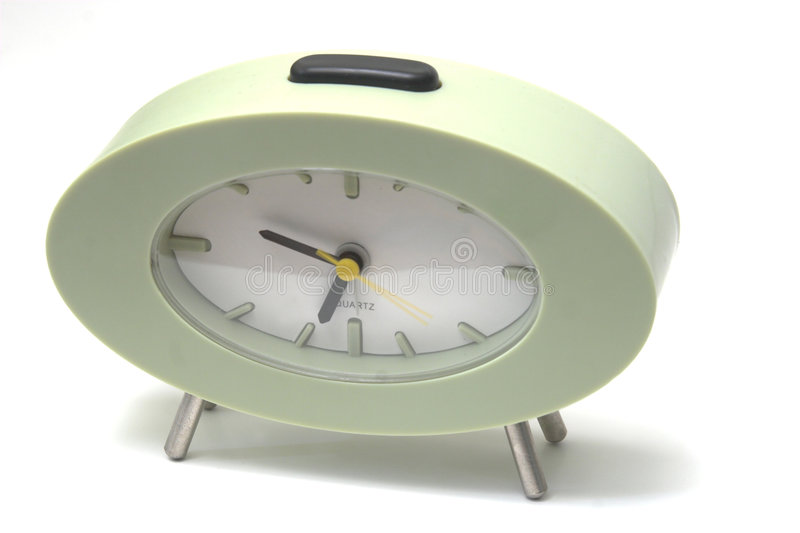 Green clock on white royalty free stock photos
