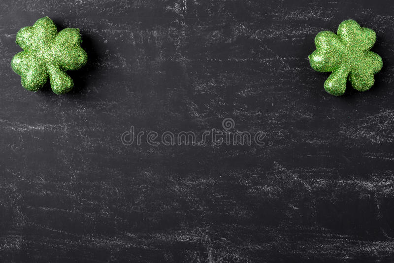 Green Clovers on Chalkboard Background. For St. Patrick's Day Holiday stock photo