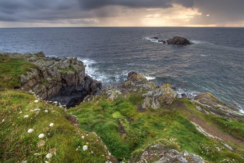 Green coastline at dusk royalty free stock images