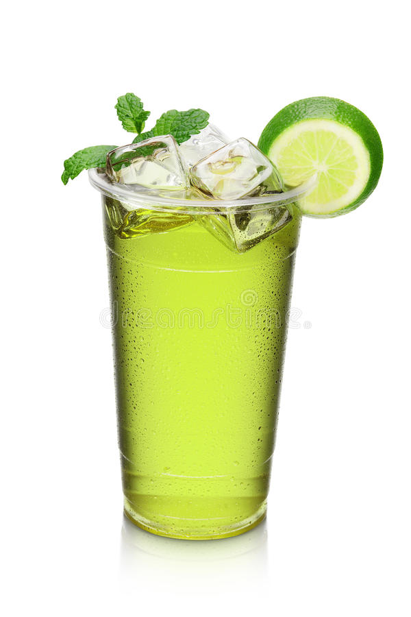 Green cocktail drink with lime slice and mint stock photography