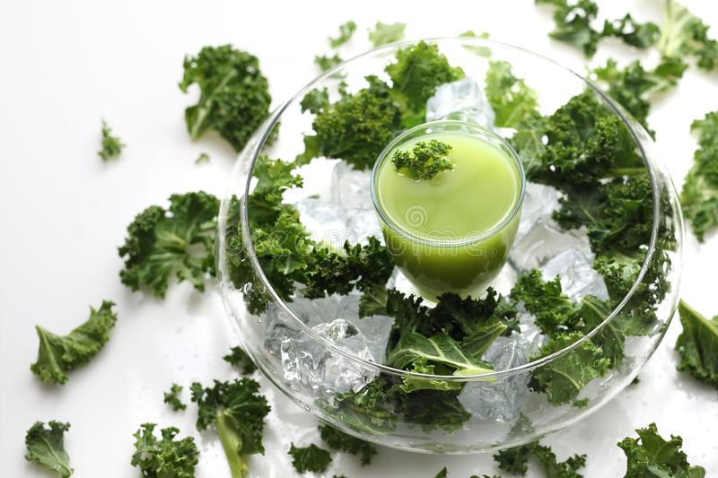 Green cocktail with leaves of kale, apples, banana, kiwi. stock image