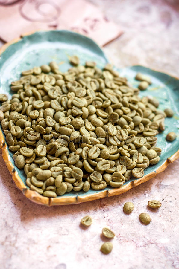 Green coffee beans. Green coffee, tasty eco-product, for weight loss and health. beans stock images