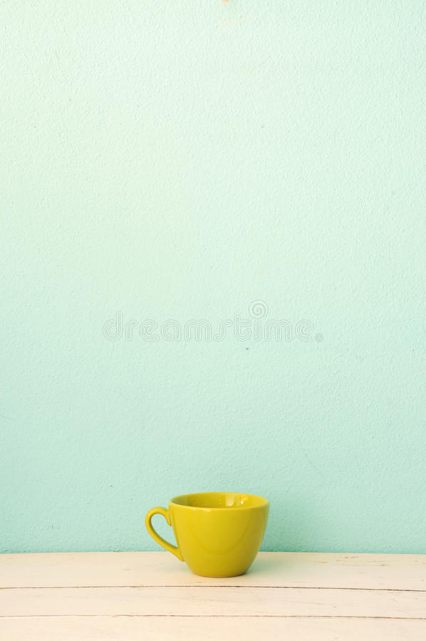 Green Coffee Cup On The White Wood Stock Image