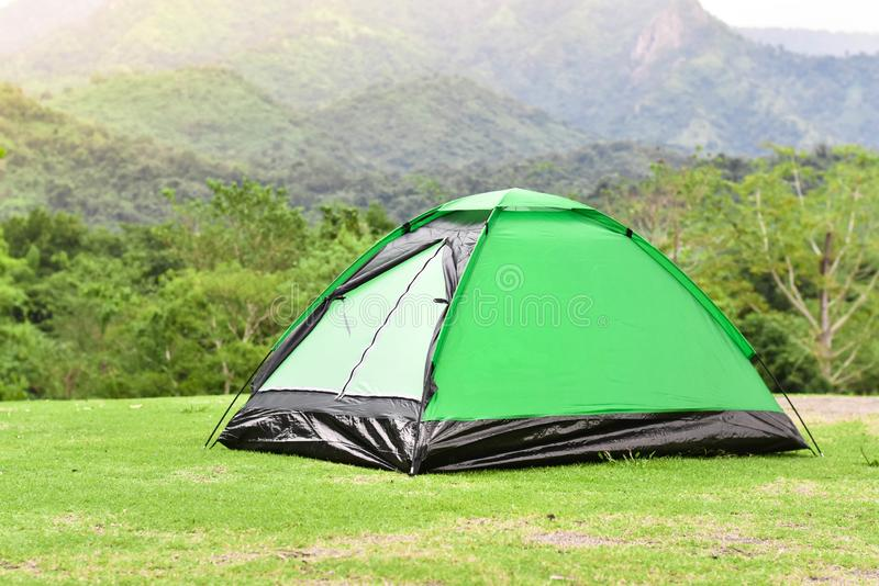 Green color dome tent and mountain range landscapes in the background. Camping tent royalty free stock photos