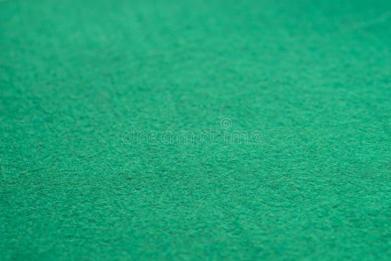 Green color felt backgroun texture selective focus. Macro stock photos