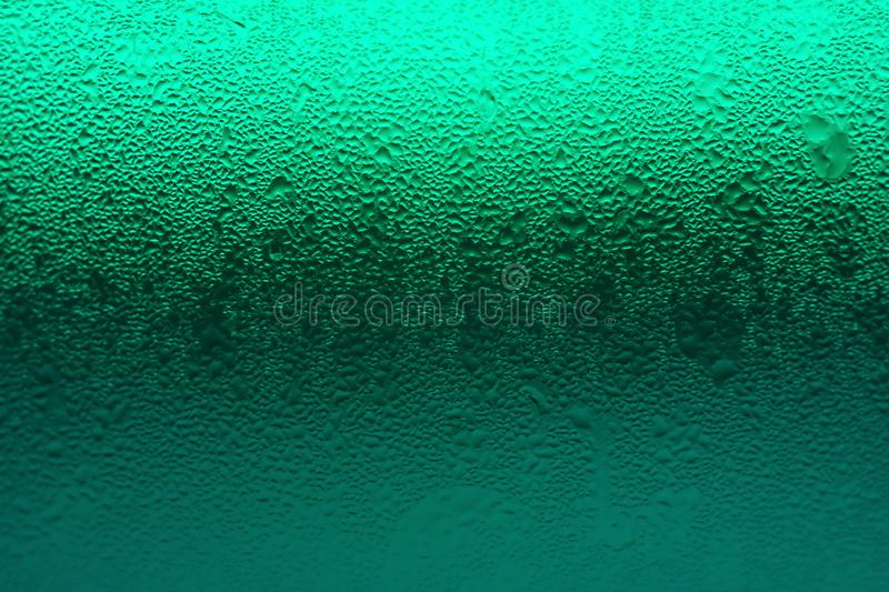 Green color gradation of beverage glass with condensation for texture background royalty free stock photography