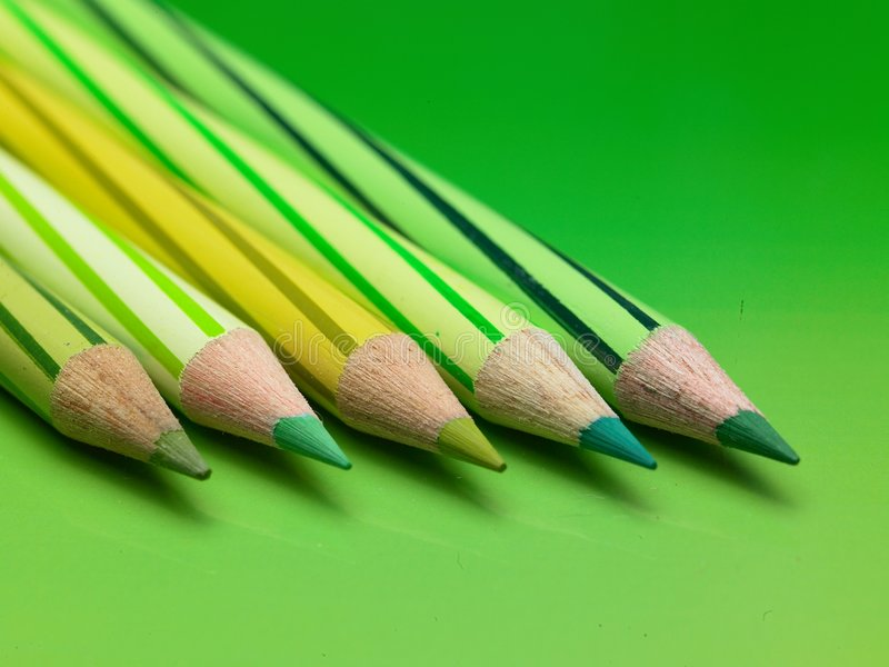 Green color pencils. Five green color pencils used for coloring royalty free stock image