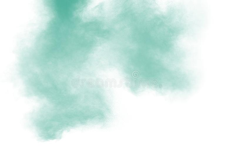 Green color powder explosion cloud on white background. Green dust splash stock images