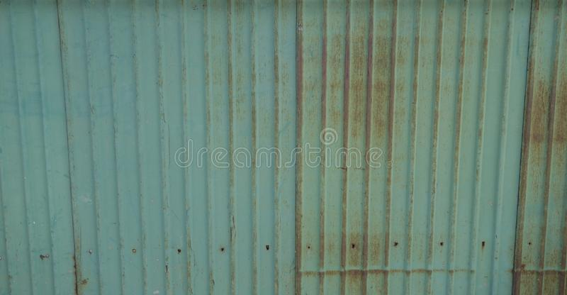 Green color rusted corrugated zinc sheet stock photography
