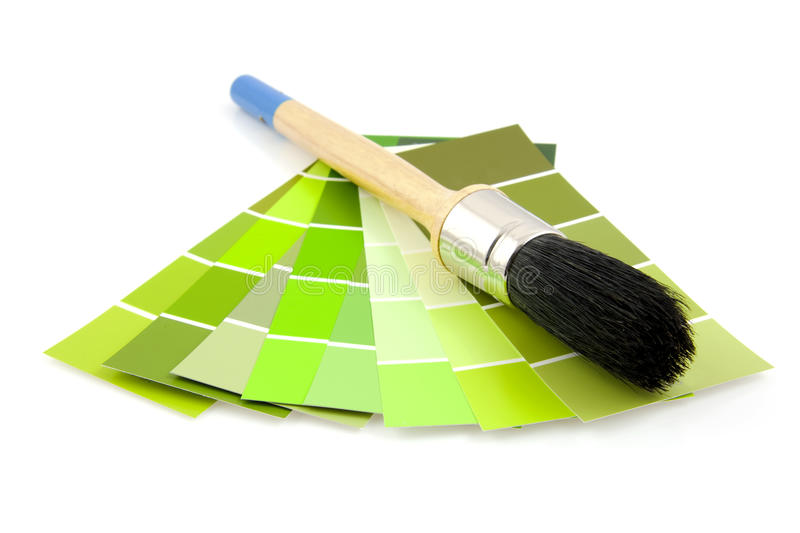 Green color samples and paint brush royalty free stock images