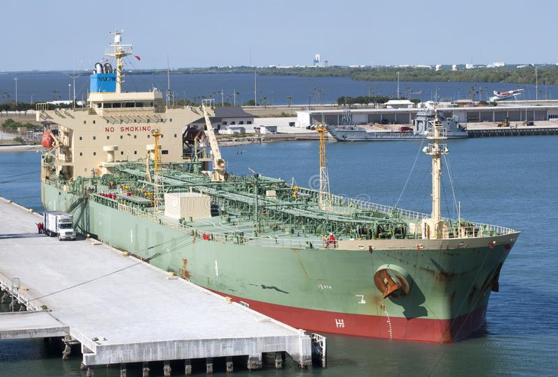 Port Canaveral Tanker. The green color tanker moored in Cape Canaveral city port Florida royalty free stock images