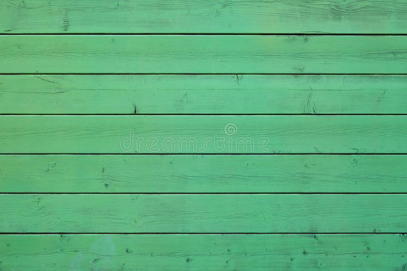 Green colored pastel wood background. Wooden abstract background stock image