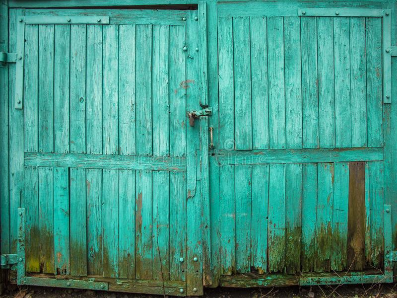 Green colored wooden texture of garage door. stock photos