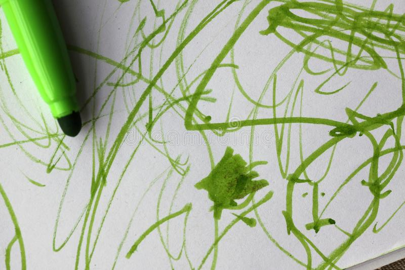 Green colour kid`s creative drawing stock photography