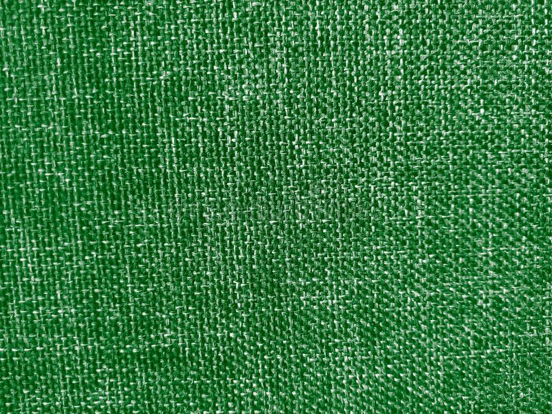 Green coloured thick cloth material background,close up shot. Useful for web,banner and poster design royalty free stock image