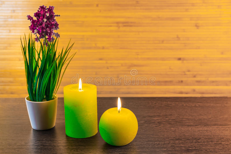 Green concept with candles. Green spa concept with candles and flowers royalty free stock photography