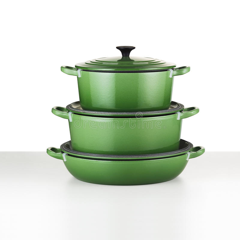 Green cookware. Cookware stacked green, with clipping path stock photos