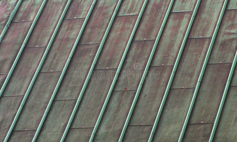 Green Copper Roof. Green weathered oxidized copper roof stock photos