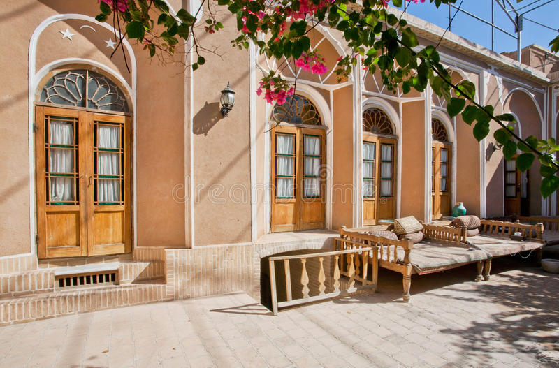 Green courtyard of beautiful iranian mansion. YAZD, IRAN: Green courtyard of beautiful iranian mansion with Ottoman beds for relaxation. With population of 270 stock photos