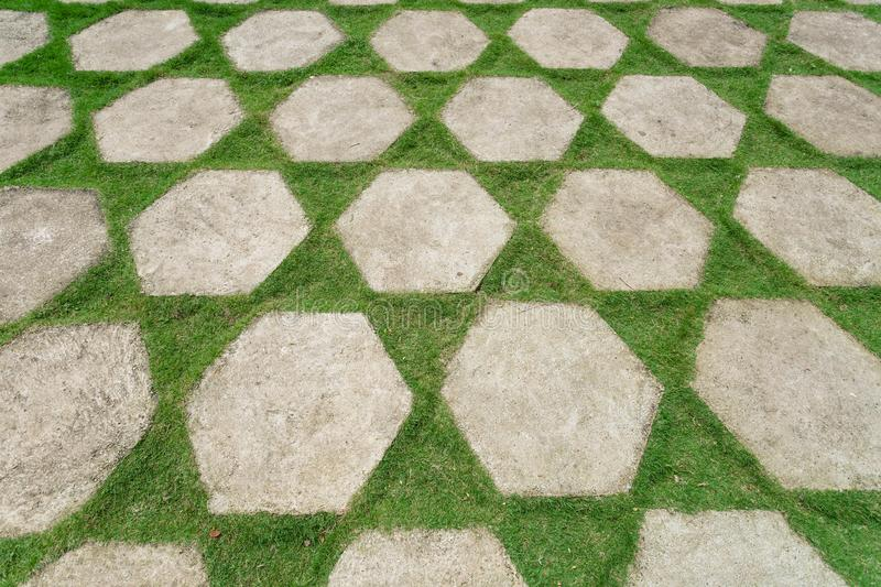 Green courtyard floor, decorated with stone slabs and grass lawn. Landscaping in Asia.  stock photos