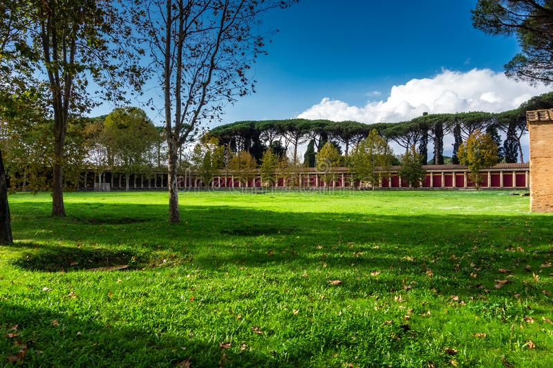 Green courtyard of the house or villa in Pompeii. The ancient Roman city destroyed eruption of the volcano Mount Vesuvius, garden, antique, architecture stock photography