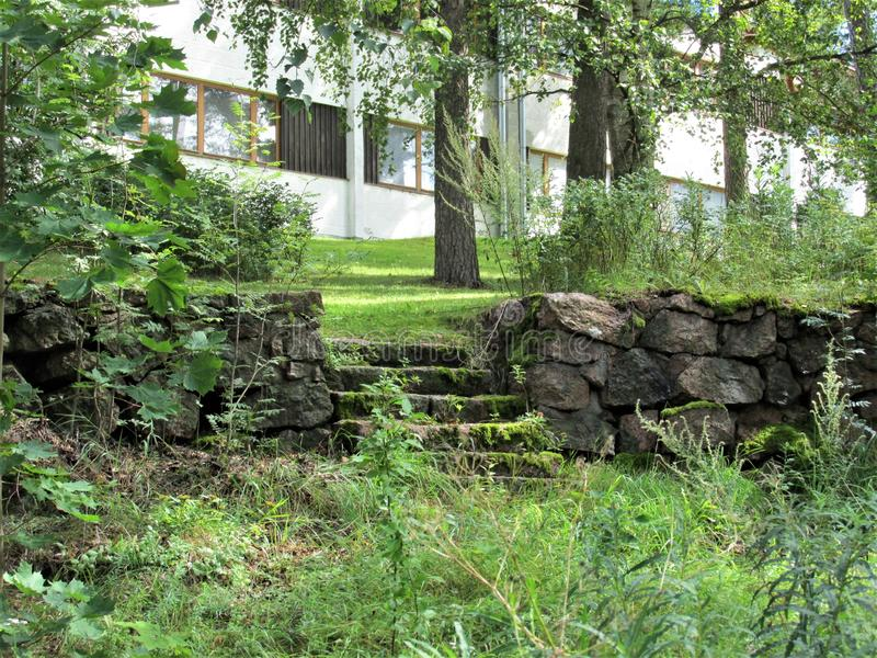 Old stairs in the green courtyard of the house. The green courtyard with old stairs near one of the houses in Lappeenranta, Finland royalty free stock image