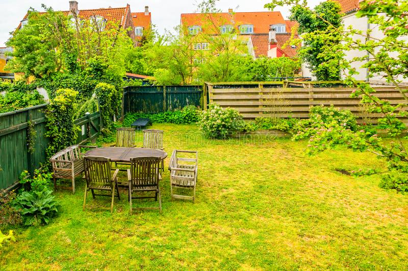 Green courtyard with table and chairs in Helsingor, Denmark.  royalty free stock images