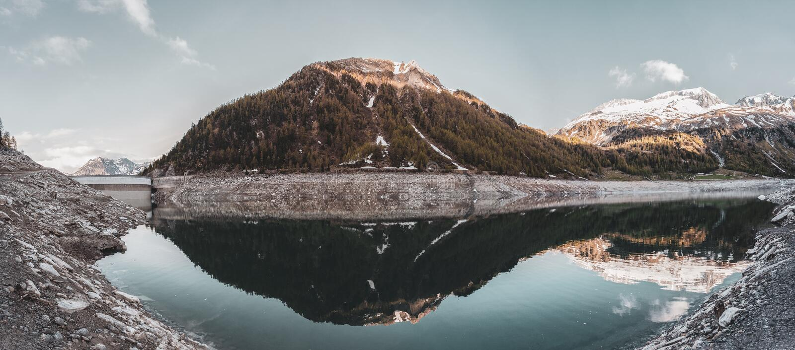 Green Covered Mountain Reflected on Calm Water Under Clear Sky Landscape Photo royalty free stock photos