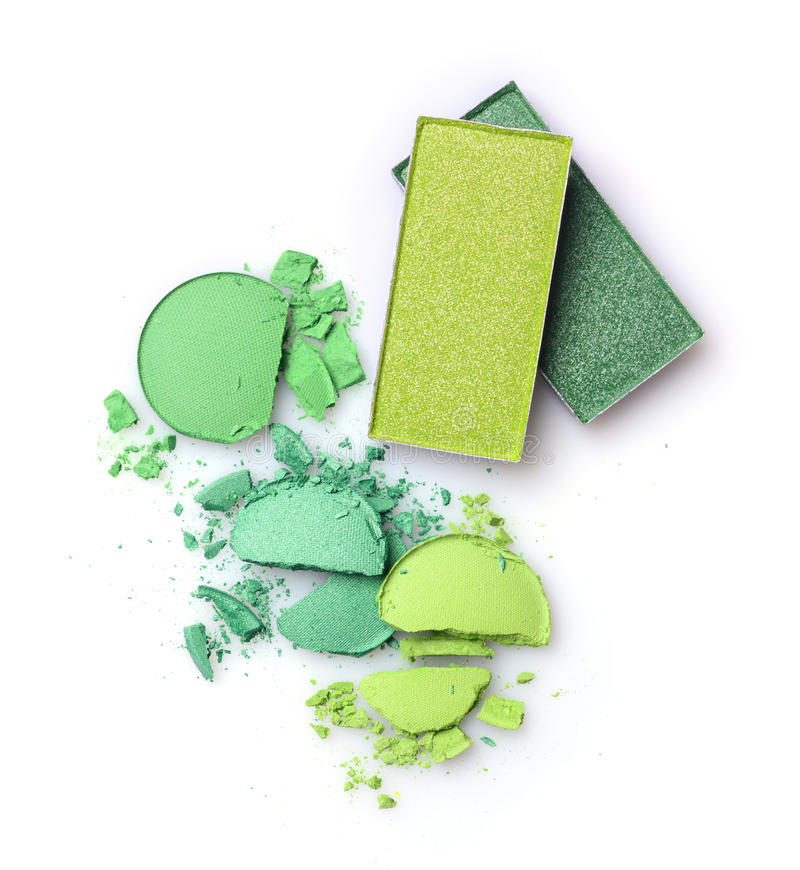 Green crashed eyeshadow for make up as sample of cosmetics product royalty free stock photos