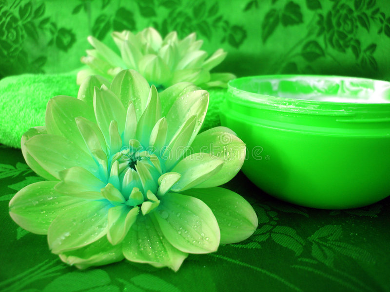 Green cream and towel stock photography
