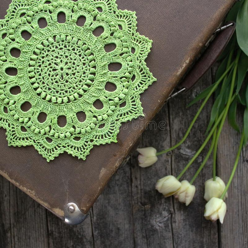 Green crocheted napkin, tulips. Retro and vintage style. The concept of spring, Easter, the sun stock photo