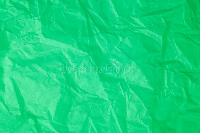 Green crumpled paper background. Green crumpled paper a background stock illustration