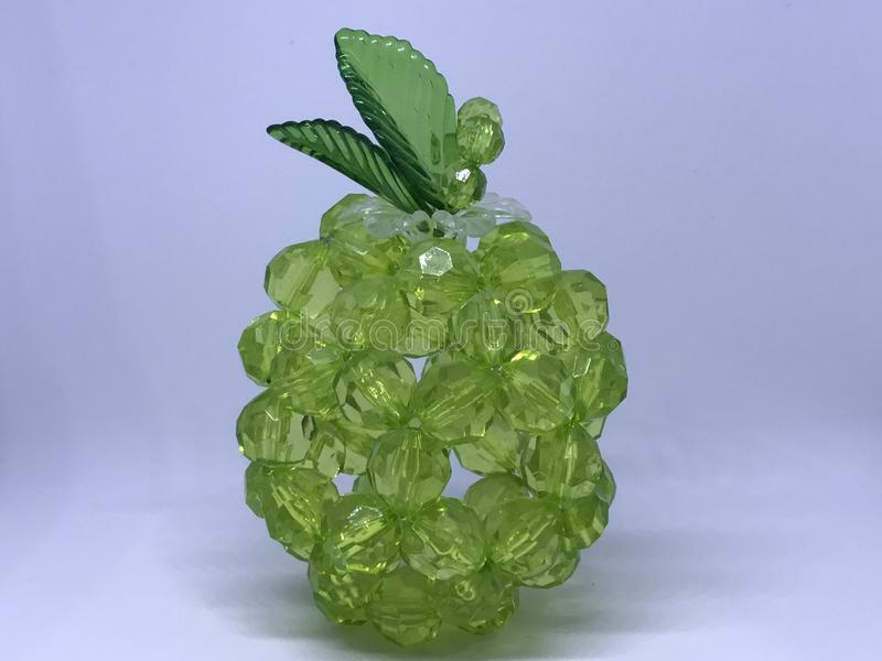 Green crystals. A fruit shape made by green crystals stock photography