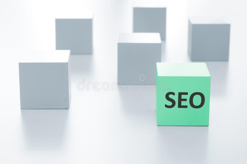 Green cube with SEO sign. Green cube with SEO sign on a white background stock photo