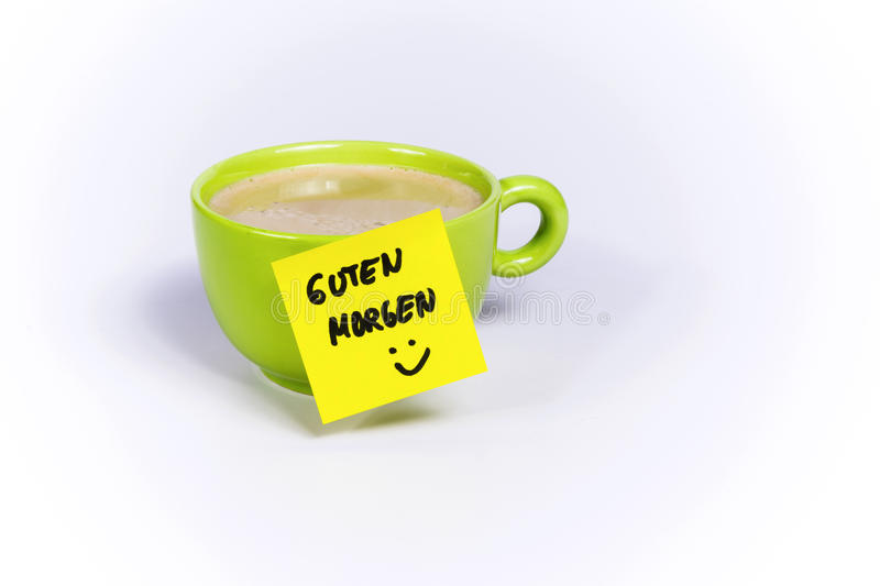 Green cup of coffee, organic coffee, post-it note good morning royalty free stock photos