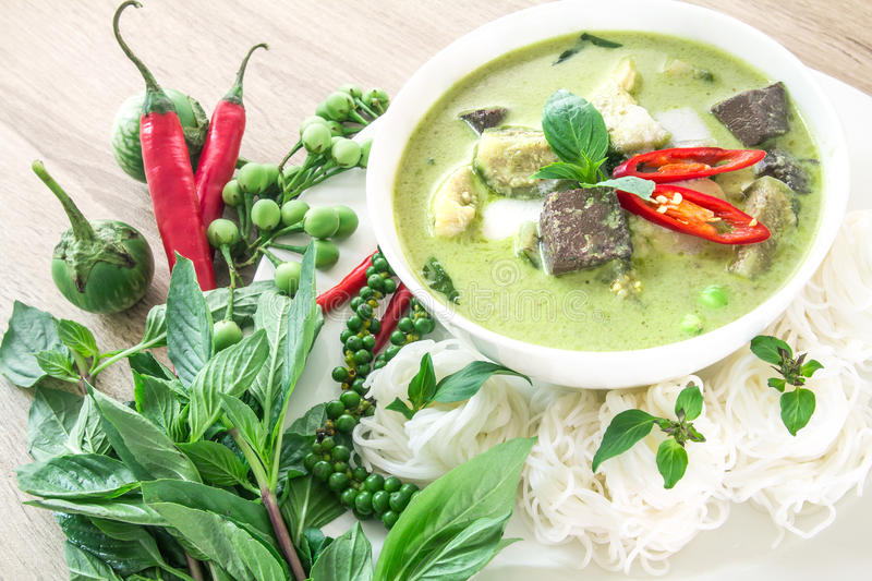 Green curry creamy coconut milk with chicken , Popular Thai food royalty free stock photography