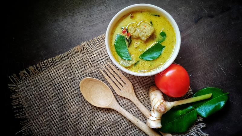 Green curry with fish ball in bowl on wood table. stock photo