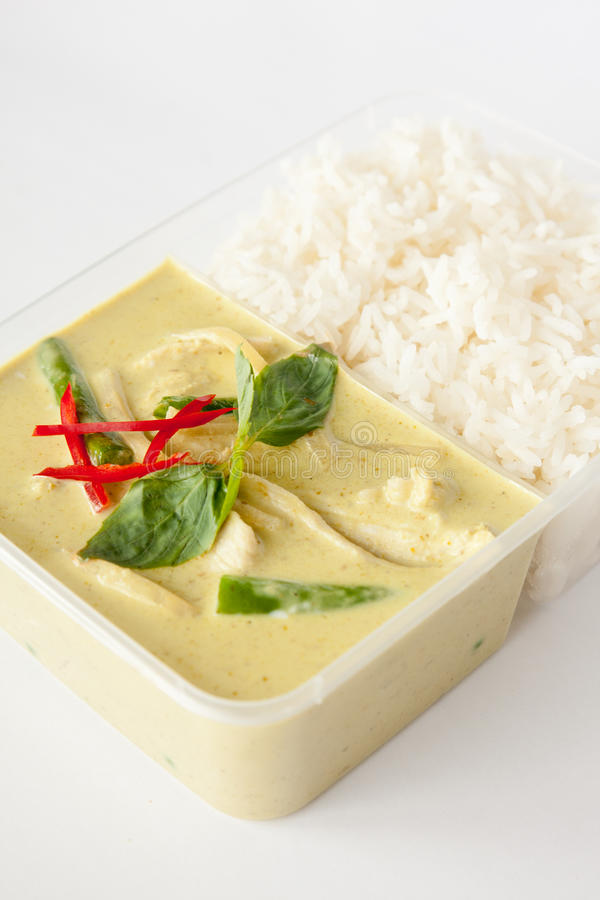 Thai take away food, green curry with rice. Green curry popular curry dish from Thai cuisine in take away box with rice royalty free stock images