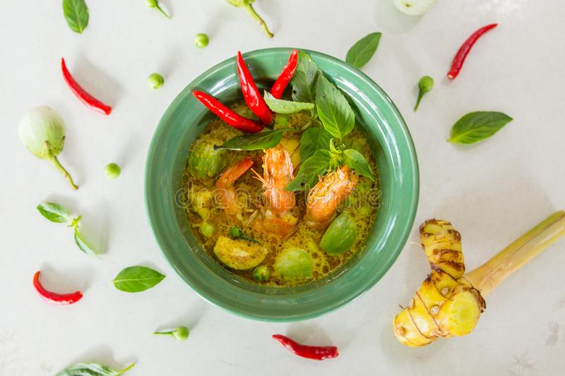 Green curry thai food chilli eggplant basil thyme shrimp Galangal oil  Mon-Khmer hill tribe milk dish cup. Sweet aroma stock photo
