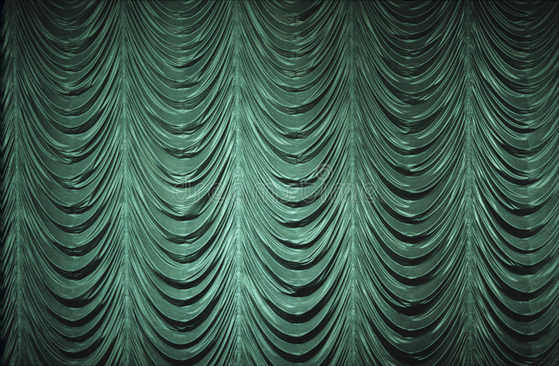 Green Curtain. A green, old-fashioned, curtain on a stage stock photography