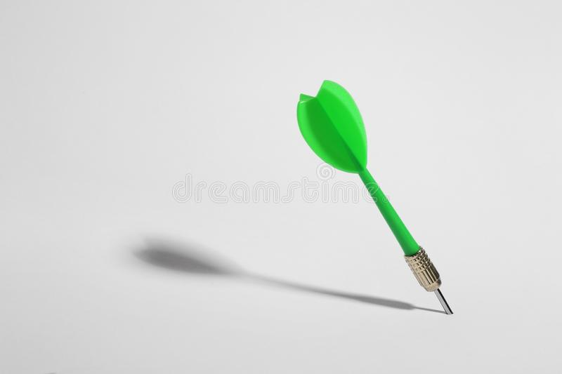 Green dart arrow for game on white. Background stock photo