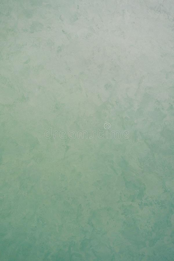 Green decorative plaster texture with pearl glow. Vertical photo stock photography