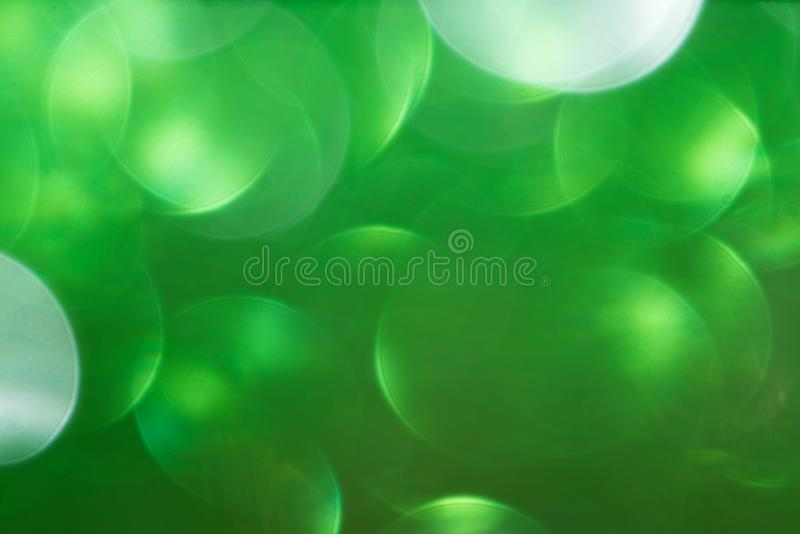 Green defocused flickering lights for text and background.  royalty free stock photos