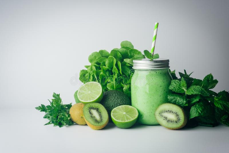 Green detox healthy smoothie from green fruit - avocado, salad, kale, lime, kiwi, mint. Alkaline diet concept. Vegan healthy. Alkaline food. Green fruit royalty free stock photo