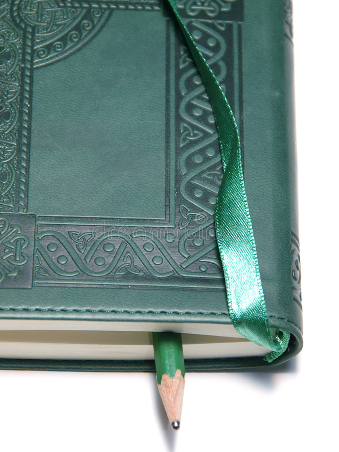 Green diary. A color photo of a green diary and pencil stock image