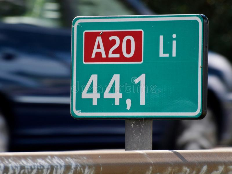 Green distance sign at 44,1 km the place where the traffic jam on motorway A20 at nieuwerkerk aan den IJssel as daily rush hour co royalty free stock photo