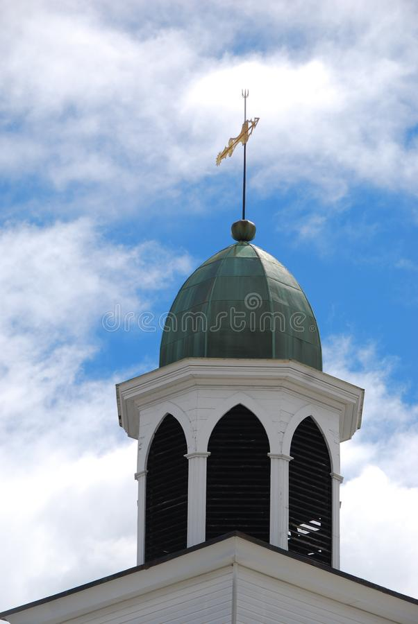 Green dome on top of white arched support structure royalty free stock images