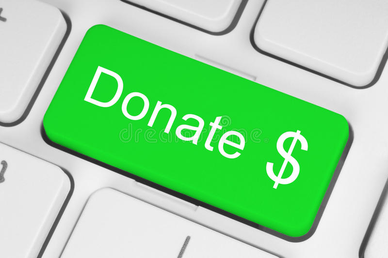 Green donate button. On the keyboard close-up stock image