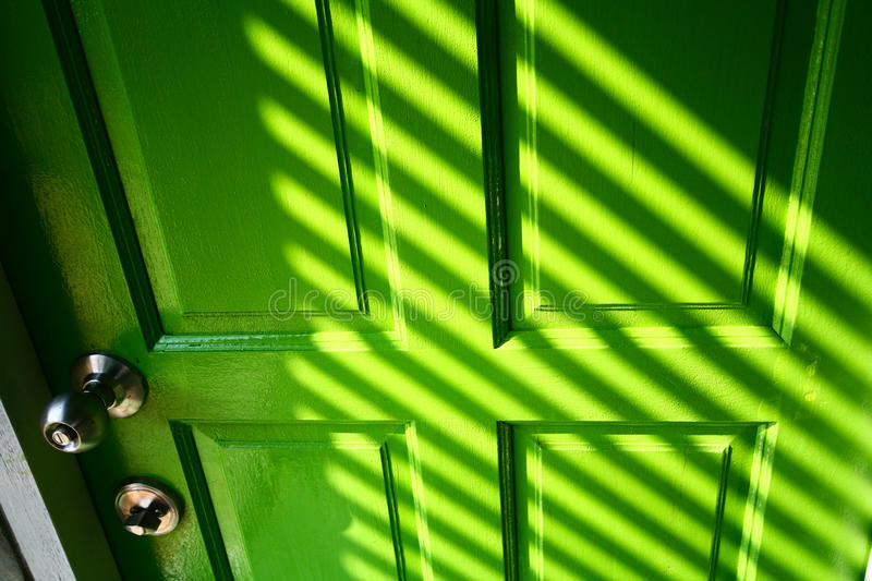 Green door. The graphic of highlight and shadow on green door royalty free stock photos